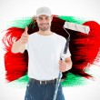 Happy man with paint roller gesturing thumbs up — Stock Photo #73224119