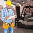 Manual worker writing on clipboard — Stock Photo #73224833