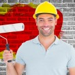 Portrait of manual worker holding paint roller — Stock Photo #73225383