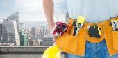 Technician with tool belt — Stock Photo