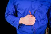 Electrician holding multimeter — Stock Photo