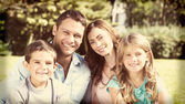 Family enjoying the sun — Stock Photo
