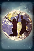 Composite image of cheerful young couple jumping — Stock Photo