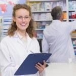 Pharmacist writing on clipboard — Stock Photo #73268265