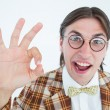 Geeky hipster doing the ok sign — Stock Photo #73268355