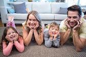 Happy family smiling at camera — Stock Photo