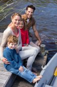 Happy family at a lake — Stock Photo