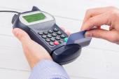 Man swiping his credit card — Stock Photo
