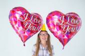 Geeky hipster holding balloons — Stock Photo