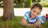 Cute little girl smiling at camera — Stock Photo