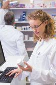 Pharmacist looking at medicine — Stock Photo