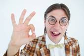 Geeky hipster doing the ok sign — Stock Photo