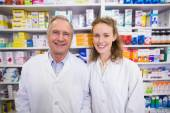 Pharmacists looking at the camera — Stock Photo