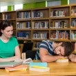 Students studying together in the library — Stock Photo #73270011