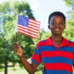 Little boy waving american flag — Stock Photo #73270921