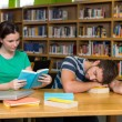 Students studying together in the library — Stock Photo #73271043