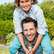 Father and son smiling at camera — Stock Photo #73273371