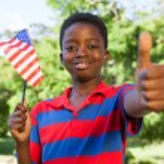 Little boy waving american flag — Stock Photo #73275061