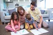 Happy family spending time together — Stock Photo