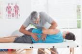 Doctor examining man back — Stock Photo