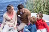 Happy family at a lake — Stock Photo