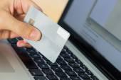 Man using laptop for online shopping — Stock Photo