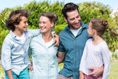 Happy family smiling at each other — Stock Photo