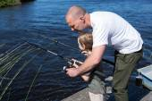 Happy man fishing with his son — Stock Photo