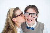 Geeky hipster kissing boyfriend — Stock Photo