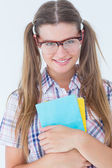 Geeky hipster smiling at camera — Stock Photo