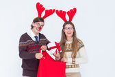 Geeky hipster couple holding present — Stock Photo