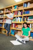 Students reading in the library  — Stock Photo