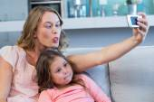 Happy mother and daughter taking selfie — Stock Photo