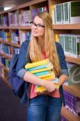 Pretty student in the library — Stock Photo