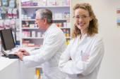 Pharmacist smiling at camera — Stock Photo