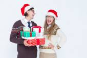 Geeky hipster couple holding presents — Stock Photo