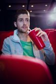 Young man watching a film — Stock Photo