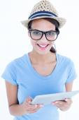 Smiling woman using her tablet looking at camera  — Foto de Stock