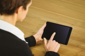 Businesswoman using tablet at desk — Stock Photo