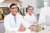 Smiling scientists looking at camera  — Stockfoto