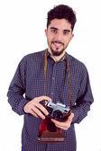 Homem casual, segurando sua câmera — Fotografia Stock