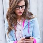 Pretty brunette woman using smartphone — Stock Photo #73423527