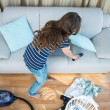Brunette woman cleaning the living room — Stock Photo #73428013