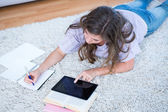 Pretty woman with books and tablet pc  — Stock Photo