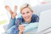 Blonde woman doing online shopping — Stock Photo