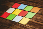 Colorful sticky post its on wooden background — Stock Photo