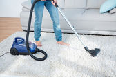 Woman using vacuum cleaner — Stock Photo