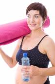 Pregnant woman keeping in shape — Stock Photo