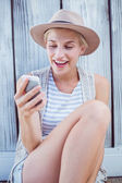 Blonde woman texting with mobile phone — Stock Photo