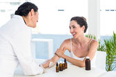 Doctor doing skin prick test at her patient — Stock Photo
